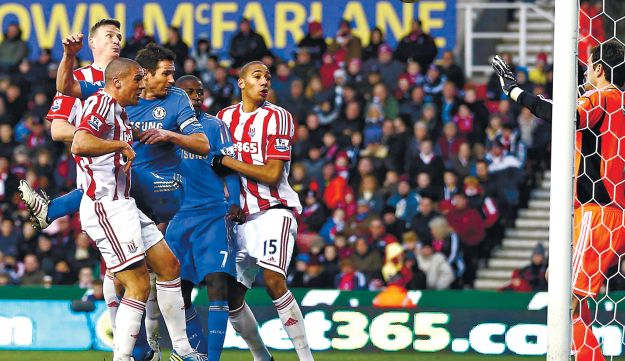 Stoke's Jonathan Walters, 2nd left, scoring his second own goal against Chelsea