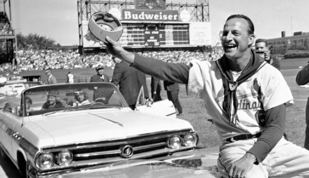 St. Louis Cardinals' Stan Musial waves to fans during ceremonies marking his last game