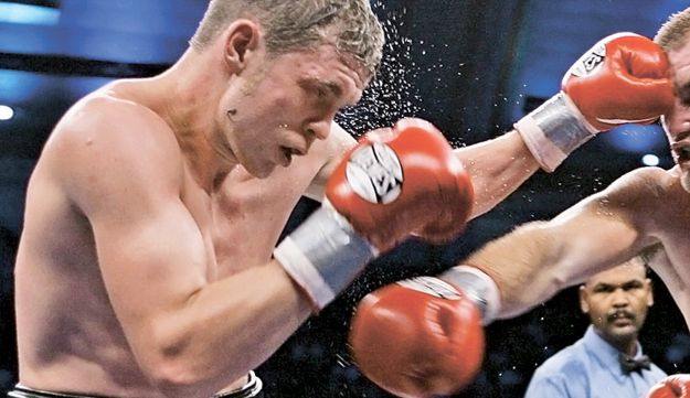 Foreman facing Donny McCrary in 2006 bout.  AP