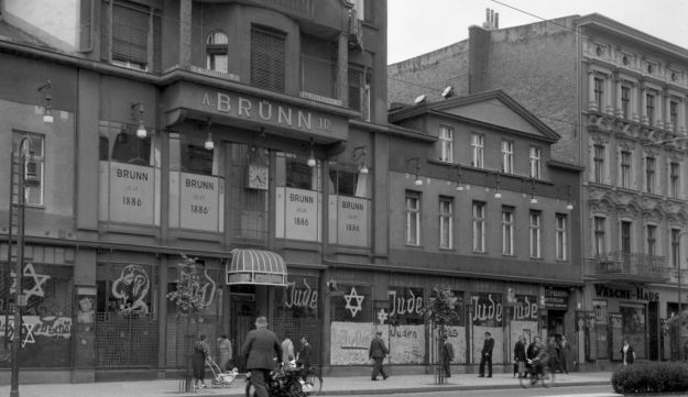 A Bruenn JR shop, a Jewish-run store after it has been vandalized by Nazis and its frontwall inscripted with anti-Semitic graffiti after Kristallnacht.