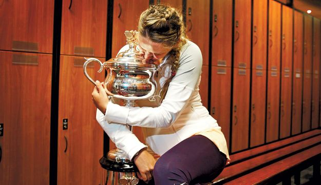 Victoria Azarenka posing in the locker room with The Daphne Akhurst Memorial Cup.