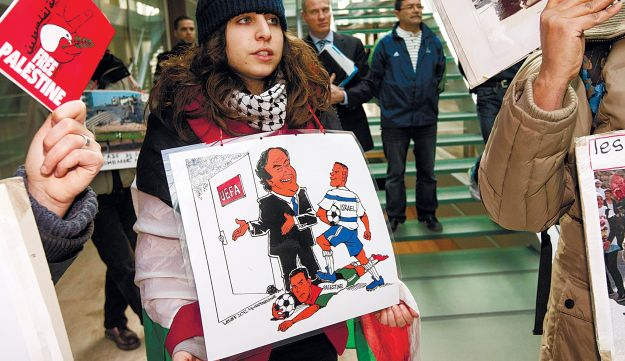 Pro-Palestinian protesters at the UEFA headquarters, January 25, 2013.