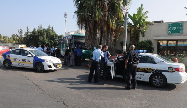 Israel Police vehicles are seen at the Afula central bus station, Nov. 13, 2013