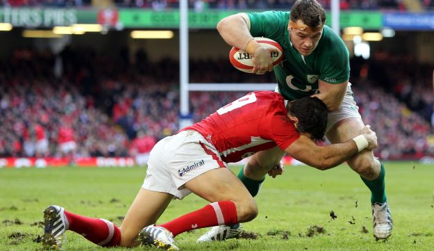 Ireland's Cian Healy, right, is tackled by Wales' Mike Phillips on his way to scoring.