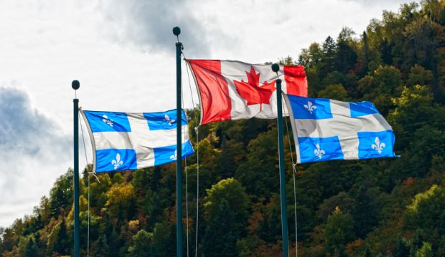 Canadian and the Quebec flags.