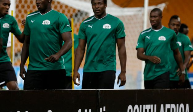 Burkina Faso national soccer team players participate in a pre-match training session
