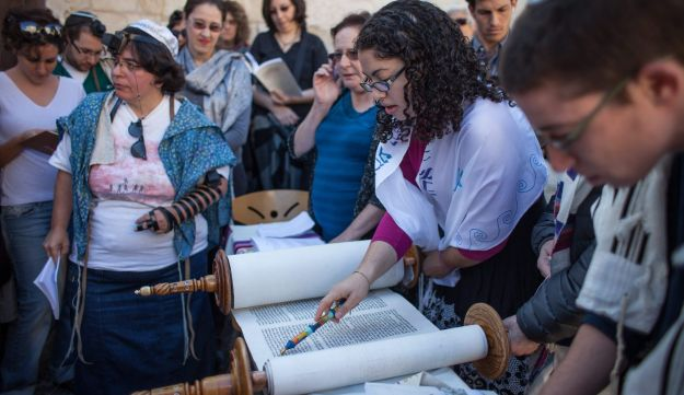 Member of Israeli group Women of the Wall reads from Torah scroll at Western Wall, May 2012.