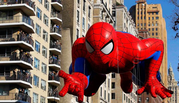 A Spiderman balloon floats down Central Park West in a parade, New York, Nov. 22, 2012.