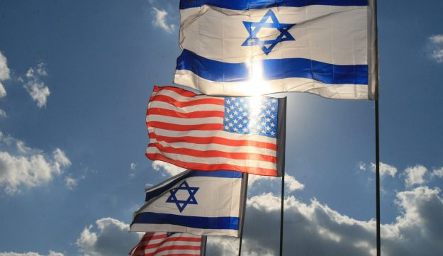 Israeli and American flags.
