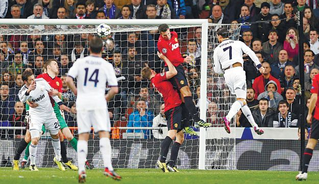 Real Madrid's Cristiano Ronaldo of Portugal heading the ball during a Champions League round