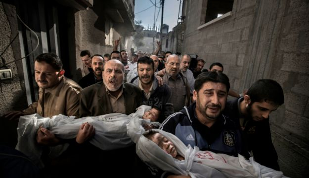 Bodies of 2-year-old Suhaib Hajizi (left) and his 3-year-old brother Muhammad, killed in Israeli airstrike during Operation Pillar of Defense, brought for burial in Gaza, November 19, 2012.