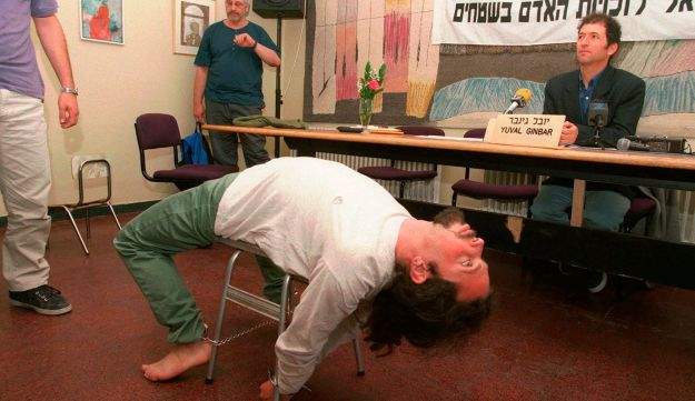 An Israeli actor demonstrating a torture technique reportedly used by the Shin Bet.