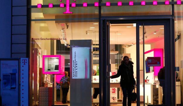 A customer leaves a Deutsche Telekom AG store in Bonn, Germany, on Monday, Dec. 17, 2012.
