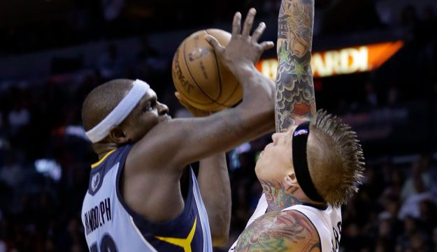 Memphis Grizzlies' Zach Randolph goes to the basket as Miami Heat's Chris Andersen defends. Friday,