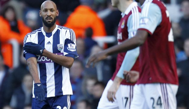 French striker Nicolas Anelka performs the 'quenelle' after scoring a goal.
