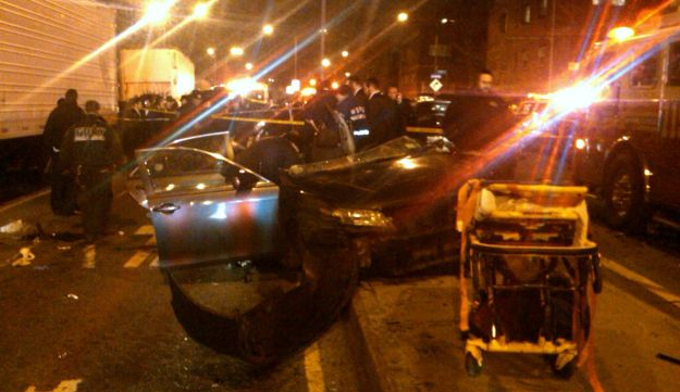 First responders work at the scene shortly after a car accident in Brooklyn