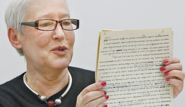 Ina Lancman holding of one her father's Yiddish manuscripts in Warsaw, March 5, 2013.