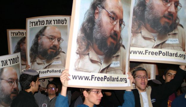 Holding placards with the Pollard's picture, right-wing activists protest for his release.