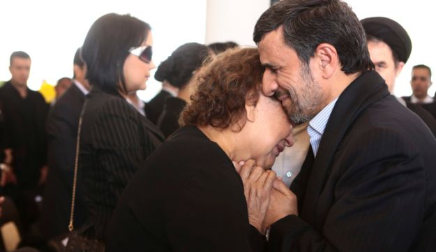 Iran's Ahmadinejad comforts mother of Venezuela's late President Chavez during the funeral