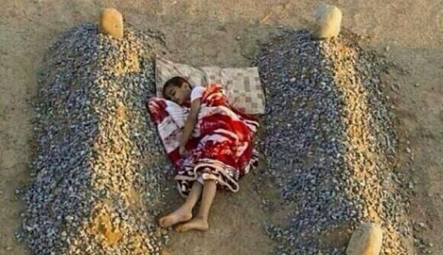 Tweeted picture of 'Syrian boy sleeping between parents' grave'
