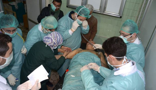Medics attend to a man at a hospital in Khan al-Assal, Aleppo, Syria.