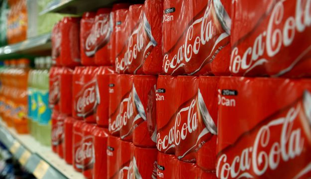 Packaged cans of Coca-Cola Co. soda are displayed for sale.