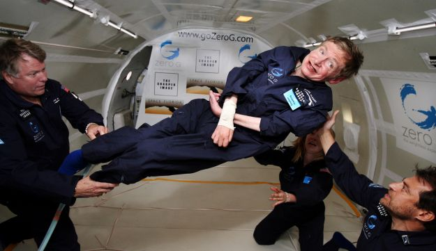 Stephen Hawking (center) enjoys zero gravity during a flight aboard a modified Boeing 727 aircraft.
