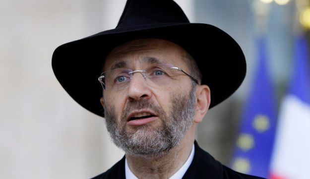 France's Chief Rabbi Gilles Bernheim, left, talks to the media