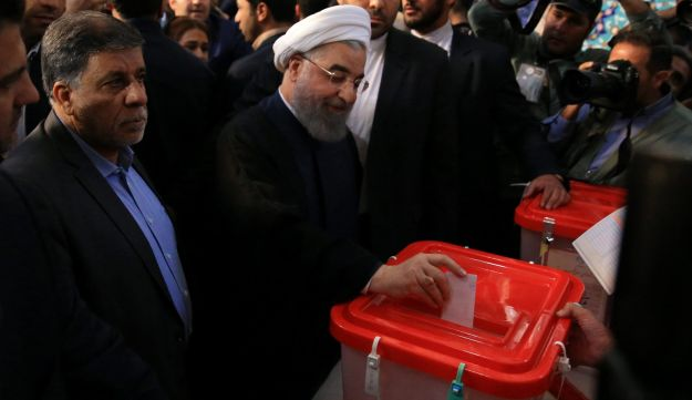Iranian President Hassan Rohani casts his vote during the presidential election in Tehran, May 19, 2017.