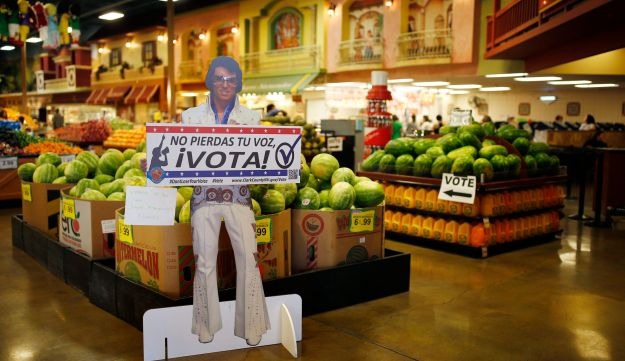 "A sign in Spanish which translates, ""Don't Lose Your Voice, Vote!"" is displayed near a polling place in a Cardenas supermarket in Las Vegas on Friday, June 10, 2016."