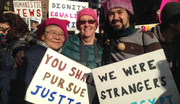 Amy and her partner Nancy, with their son Joseph, made pink hats for friends in their Jewish community ahead of the Women's March on NYC, January 21, 2017.