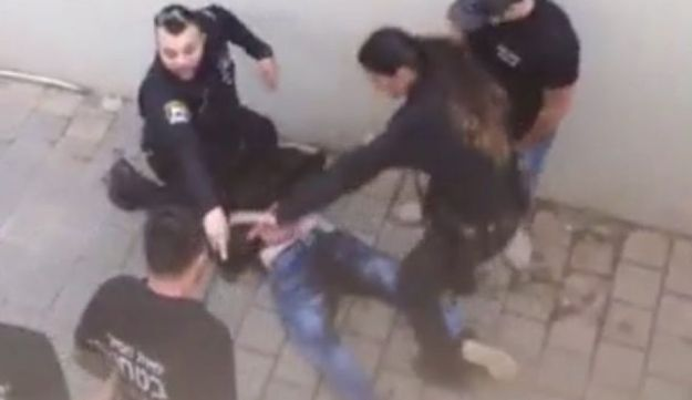 The assailant in the Ra'anana stabbing attack being apprehended, December 19, 2015.
