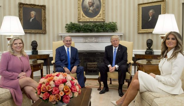 Donald Trump and Benjamin Netanyahu, along with their wives, Melania Trump and Sara Netanyahu, hold a meeting in the Oval Office of the White House in Washington, DC, February 15, 2017.