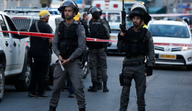 Israeli Border Police stand guard following the shooting attack in Jerusalem, March 8, 2016.