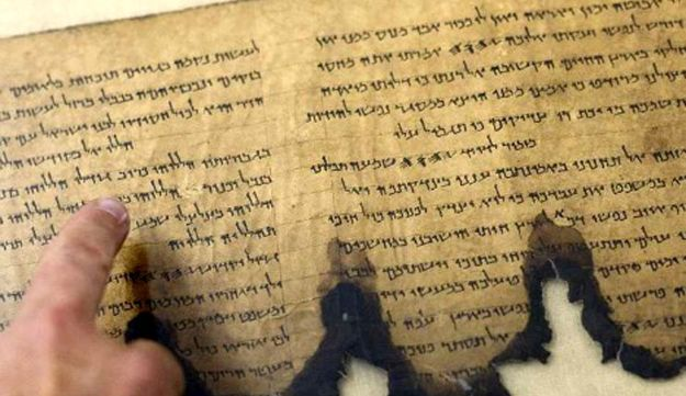 A fragment of the Dead Sea Scrolls at an Israel Antiquities Authority conservation laboratory in Jerusalem, October 19, 2010.