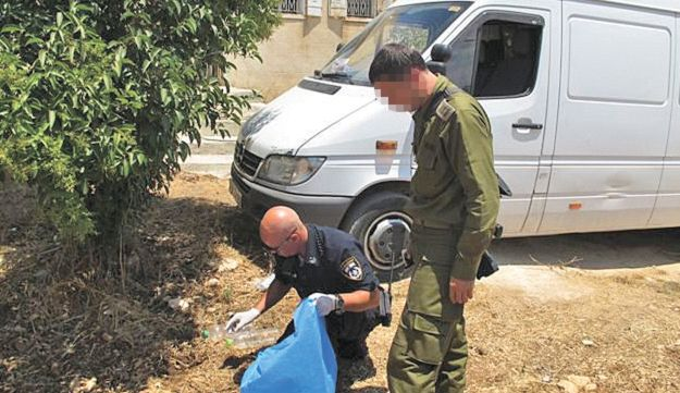 Israeli authorities collect evidence after flammable material  is left under a Palestinian's truck.