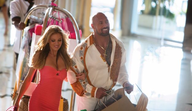 "Bar Paly and Dwayne Johnson in ""Gain & Pain""."