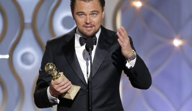 Leonardo DiCaprio, receives a Golden Globe for his role in 'The Wolf of Wall Street,' Jan. 12, 2014.