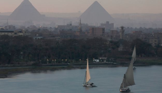 The pyramids of Giza looming over modern Cairo (AP)
