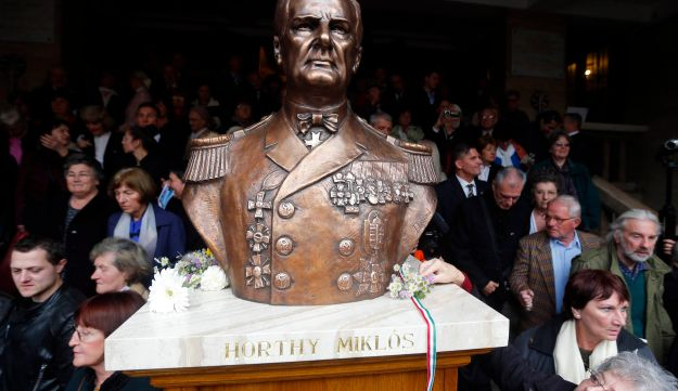 Right-wing nationalists attend a ceremony unveiling statue of wartime leader Miklos Horthy