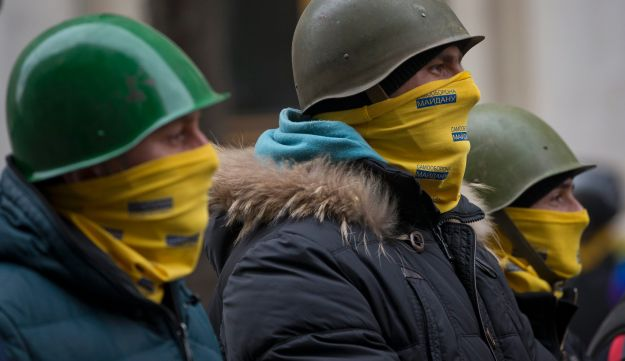 Protesters stand guard in front of presidential administrative building in central Kiev, Ukraine.