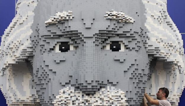 A builder makes final adjustments to a Lego display of Albert Einstein at Legoland Malaysia