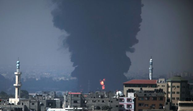 Smoke and flames rise from Gaza's power plant after it was hit by Israeli strikes on July 29, 2014.