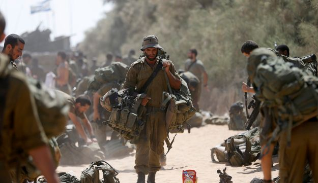An Israeli soldier returns from Gaza.