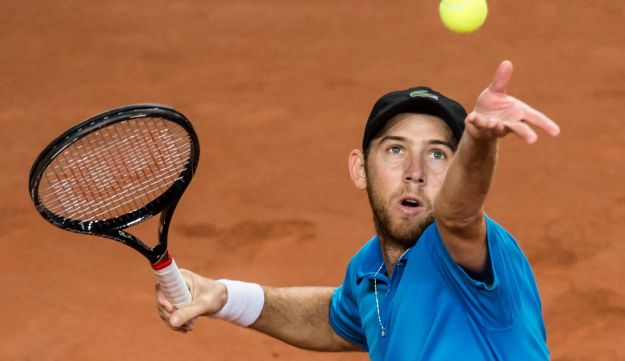 Dudi Sela serves during the World Group play-off Davis Cup tennis match in 2013.
