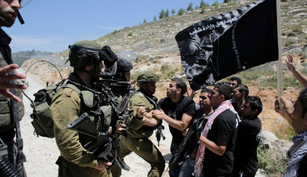 Palestinian protester scuffles with Israeli soldiers at Nakba protest in al-Walaje