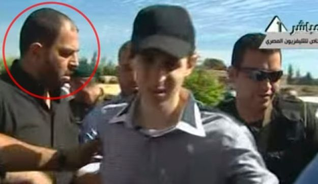Raed Al-Attar, left, seen in image of Gilad Shalit's release from Hamas abduction, October 2013.