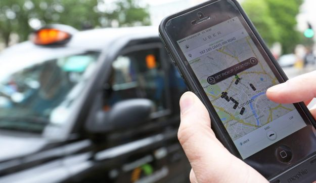 A user scans for an available vehicle using the Uber Technologies Inc.'s app on an  iPhone.
