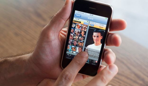 A man using Grindr on an iPhone. Used by around five million people every month.