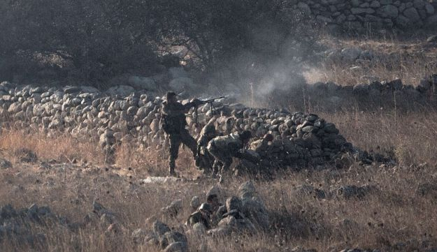 Syrian government forces battle rebel fighters, near the Quneitra border crossing.